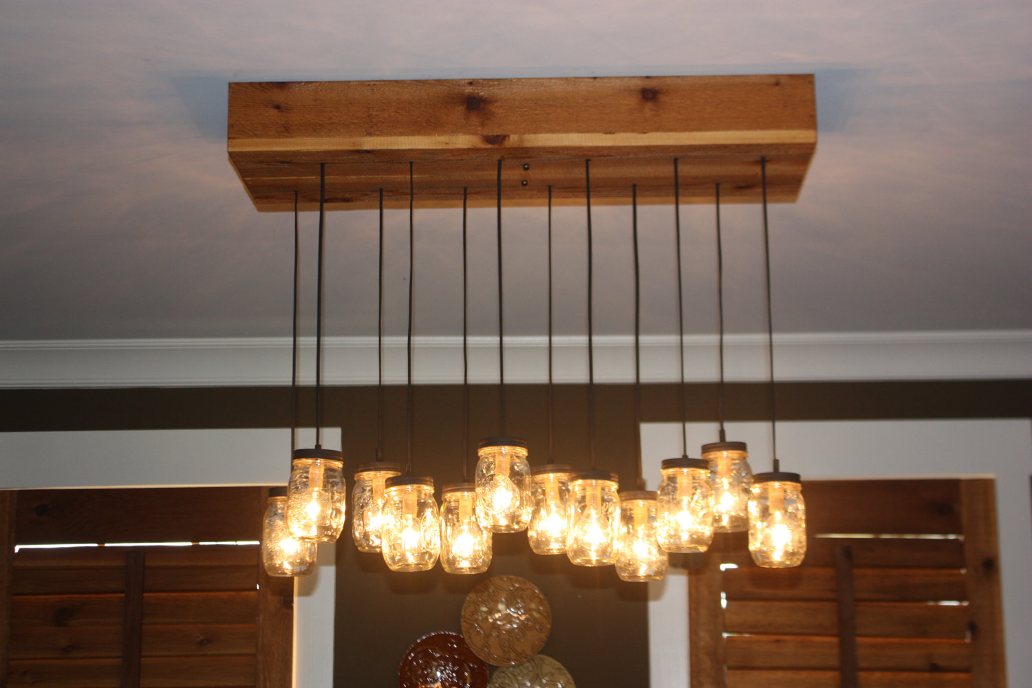 Find the uniqueness and breathtaking home lighting by installing mason jar lighting fixtures and chandeliers with cedar bases and wooden panel on the ceiling for arubaitofo Gallery