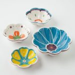 measuring cups in colorful flower shapes