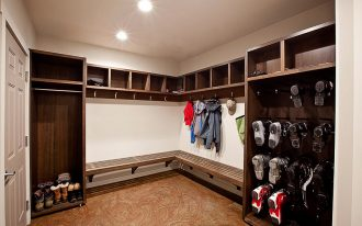 men's mudroom storage units with shelves for shoes and jackets plus wooden bench and cool flooring plus ceiling lamps and wooden door