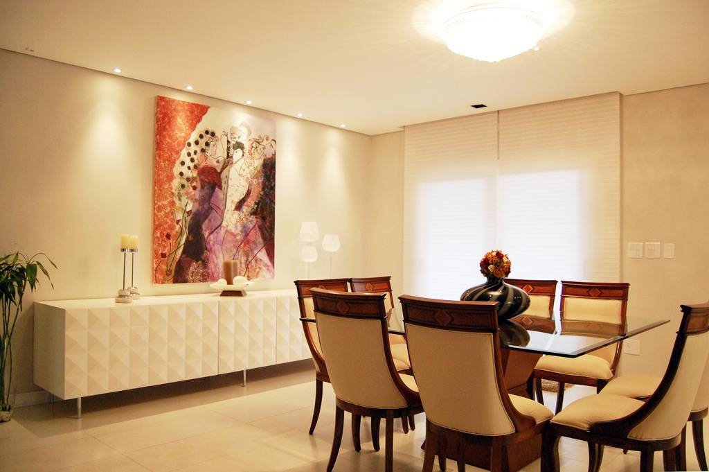 Minimalist White Sideboard With Candle Holder And Table Lamp Plus Art On Wall In Luxury Dinning