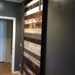 mixing wooden trim barn door idea with white black and brown tone on gray wall idea with white frame style on creamy floor