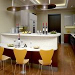 modern and stylish kitchen bar in white tone color with bright yellow bar chairs wood planks flooring for kitchen area small and simple kitchen set with storage