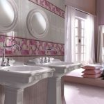 modern luxurious bathroom design with double freestanding sink design with soft pink vanity with table lamp and double round mirrors