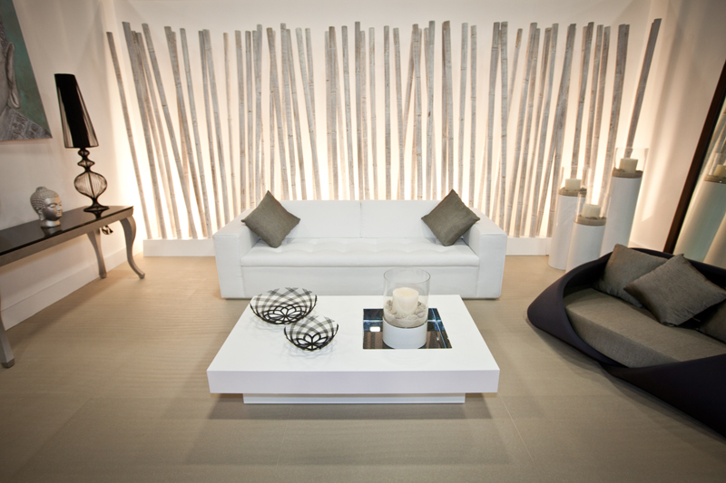 Modern Minimalist Living Room With White Sofa Plus Dark Tone Pillows Square  White Table Cool Grey