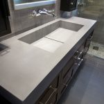 modern trough sink on modern bahthoom vanity units and vinyl countertop plus mirror ans subway tiles flooring