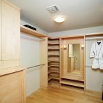 modern wooden closet organizer ideas with shelf with stainles steel hanging rod and wooden stool plus wooden floor and ceiling lamps