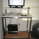monitor stand ikea on white wooden standing desk with metal leg plus computer units and keyboard plus wooden floor and window with blinds