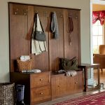 mudroom storage units in solid wooden with drawers and hanging clothes plus red rug and loundry basket home furniture ideas