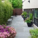 natural stones flooring for outdoor with  large concrete planter boxes and mini garden designed by Better Homes and Gardens