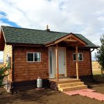 No Grid Ranch Home Design With Red Bricks Path And Wood Roofing