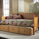 pictures of daybeds with trundle and storage plus floral bedding set and cushions and gray rug floor and pretty curtain for windows