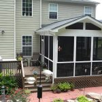 pictures of screened in porches and deck with black glasses and terrace chairs and small garden and red tiled floor
