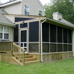 pictures of screened in porches ideas for home with dark glazing and deck plus glass door with wall scones and green grass yard