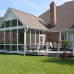 pictures of screened in porches with clear glazing and deck with terrace chairs and fence plus yard and brick wall