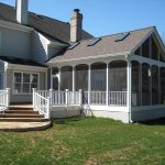 pictures of screened in porches with deck and clear glazing and stairs plus yard in pole barn house