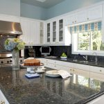 price of granite countertops in gray color combined with white wooden cabinets plus modern stove and metal lighting and window treatment for kitchen