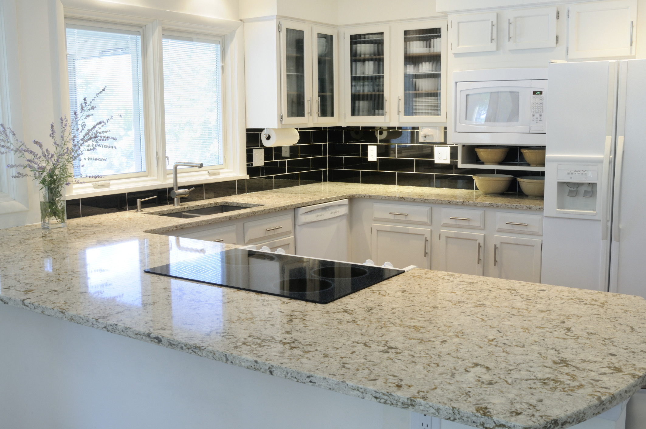 how much is the average price of granite countertops homesfeed price of granite countertops in white with wooden cabinets plus sink and black tile backsplash in