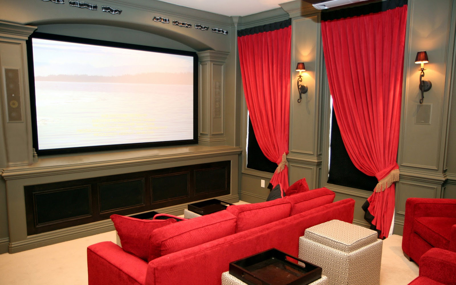 Private Home Theater With Bright Red Sofas Red Window Curtains Big Screen A  Pair Of Lighting