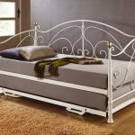queen size daybed frame with double grey bedding and metal frame with blanket and pillows plus brown rug on wooden laminating floor