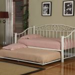 queen size daybed frame with metal frame with pink and brown bedding set and pillow plus rug on laminate floor and stand lamp