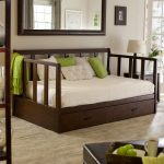 queen size daybed frame with trundle wooden bed frame with storage underneath and pillow plus green cushions and blanket and nightstand with table lamp and mirror with frame