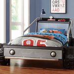 race car beds for toddlers in grey with mcqueen theme bedding plus shelf on headboard with spot light and alarm clock plus wooden floor and picture
