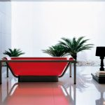 red colored bathtubs for modern bathroom with white tile floors and plants and beautiful table lamps in black