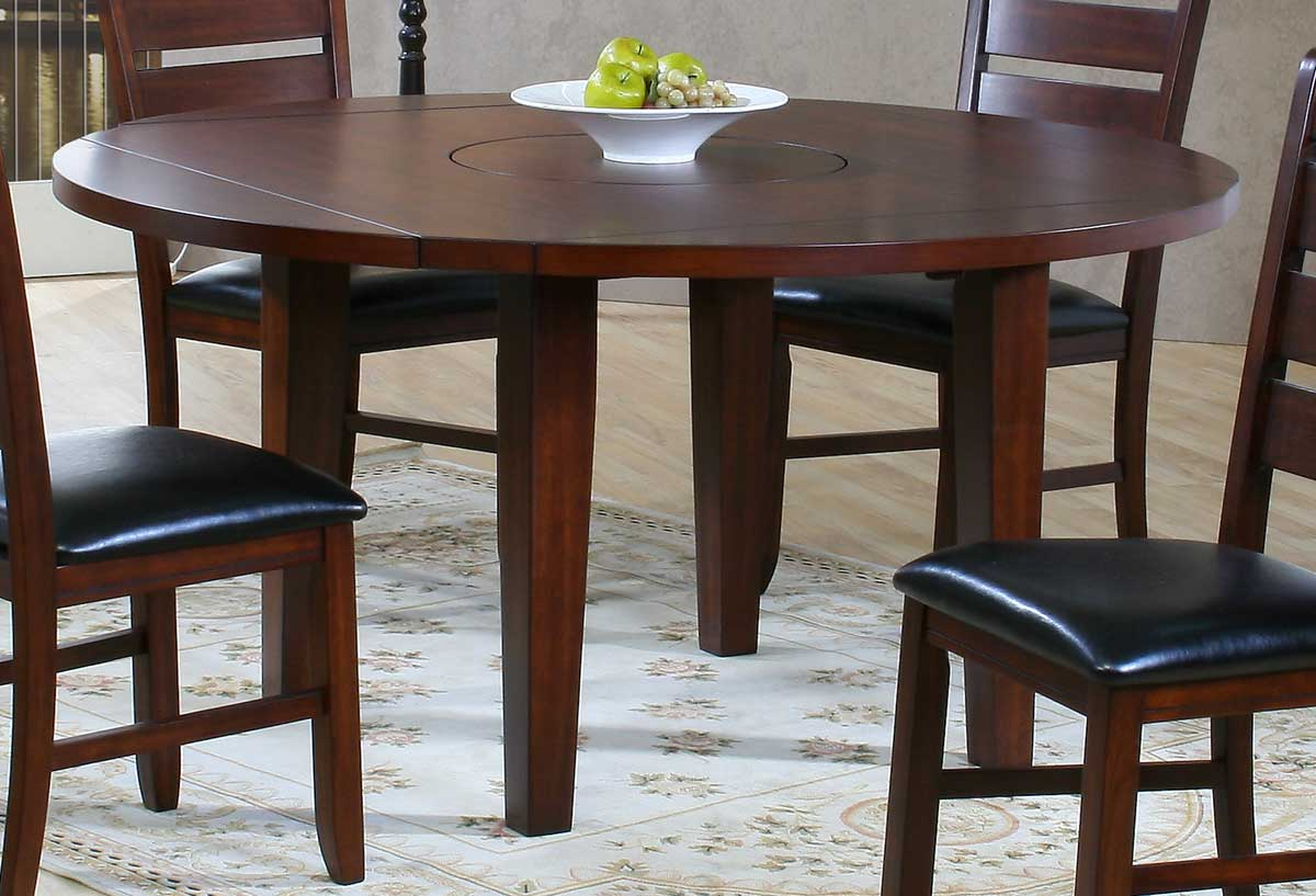 Compact dining space arrangement with drop leaf dining for Small round wood kitchen table