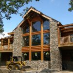 rustic log home design with natural stone structure and wide glass windows two balcony in left and right sides
