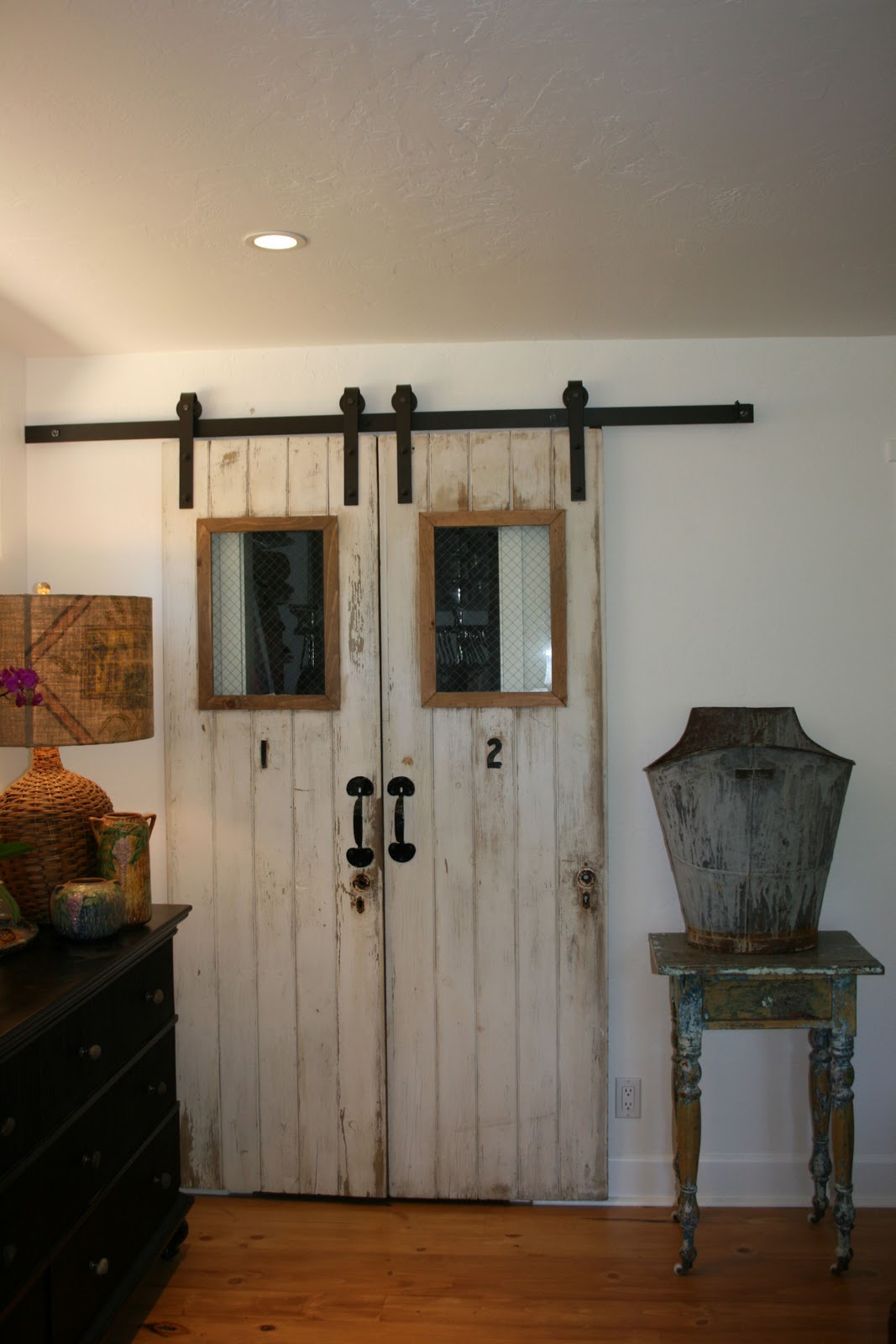 barn doors for closets that present rustic outlooks in. Black Bedroom Furniture Sets. Home Design Ideas