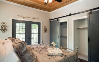 rustic sliding barn doors for closets with shelf with hanging rods in bedroom with unique bed and glass door