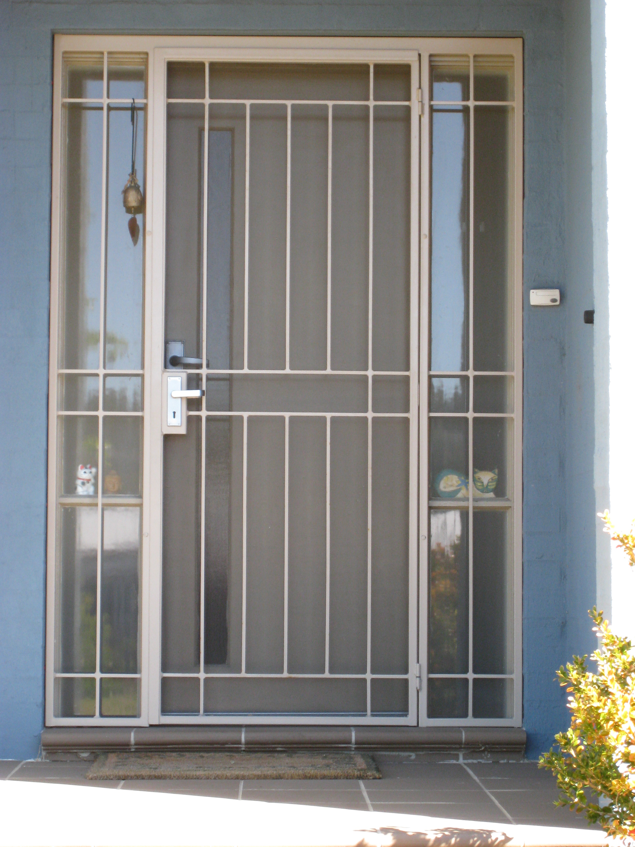 Unique design security doors homesfeed for Metal window designs