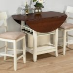 shabby chic drop leaf dining table for small spaces in wooden with white comfy chairs beautified with vase and wine plus wooden flooring