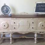 shabby chic sideboard in white with decorative plates and pretty frame plus tile floor