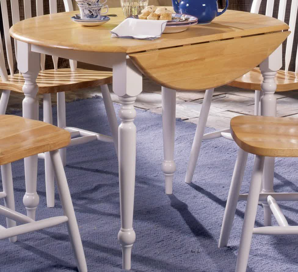 Compact dining space arrangement with drop leaf dining for Round table for small space