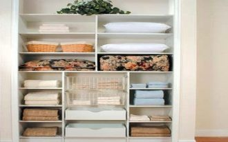 simple and tidy well organize linen closet design with vertical horizontal shape with rattan baskets and drawers and clematis