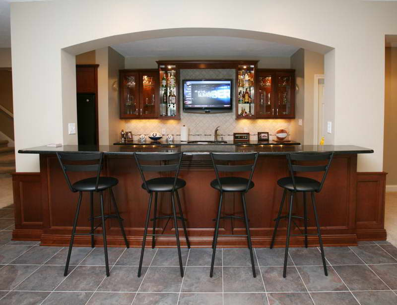 Designing A Basement Bar basement bar ideas with stone Simple Bar For Basement With Black Painted Barstools Darker Brown Bar Table Mounted Tv Screen Framed