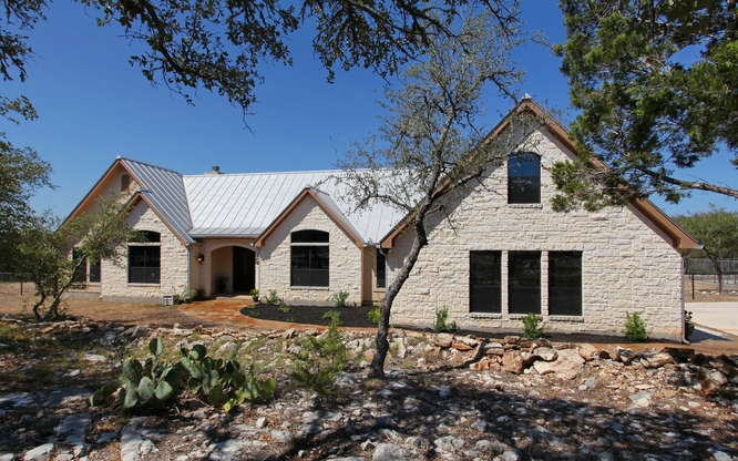 Simple But Elegant Texas Hill Country Home Design With Frameless Glasss  Windows Metal Roofing And White