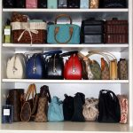 simple white handbag storage design with wooden material and simple racks and various model of branded handbag