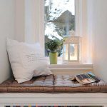 smal under window bookcase with built in daybed plus cushion and book arrangement underneath