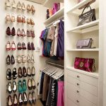 small and simple walk in closet idea with shoes storage and wardrobe storage and handbag storage in white wooden tone with drawers
