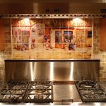 small tile spanish backsplash design above modern cooktop idea with stainless steel accent and wooden storage