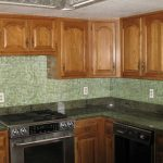 smart-green-aluminum-kitchen-backsplash-ideas-combined-with-varnished-teak-wooden-cabinet-dark-granite-countertop