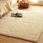 soft brown wool carpet for wood planks flooring system a pair of slippers a bed furniture