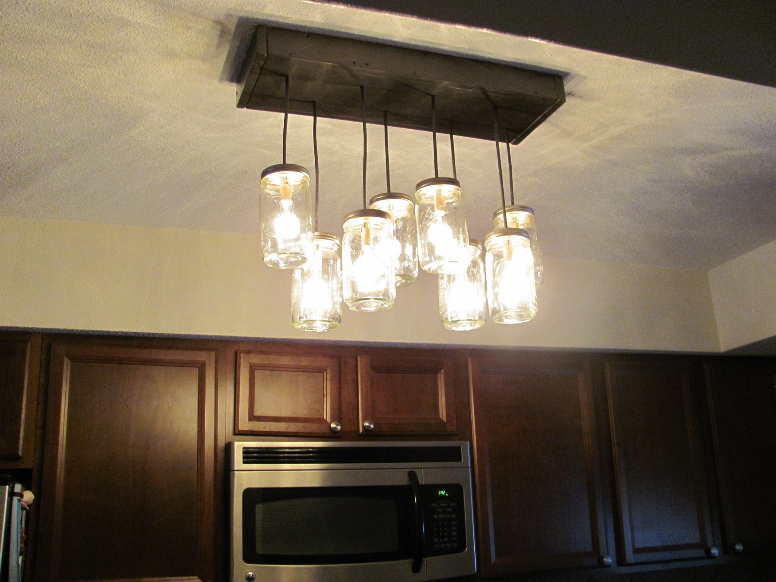 Find the uniqueness and breathtaking home lighting by installing sophisticated mason jar lighting fixtures for kitchen on white ceiling and built in oven arubaitofo Gallery