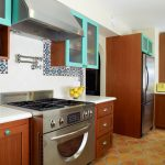 spacious kitchen design with natural tone wooden cbainetry and storage with white spanish tile backsplash idea and tosca accent