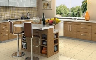 spacious modern kitchen design with wooden cabinetry and cream backsplash with frostedglass upper cabinet with small island with storage and tall stools