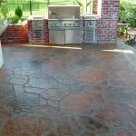 stone flooring idea over concrete design with outdoor kitchen with modern set with reddish accent and greenery