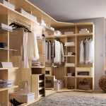 stunning cream master walk in closet desiggn with beige wooden storage for wardrobe and handbag storage and beige ball ornament and gray area rug