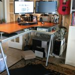 stunning orange corner standing desk design made of aluminium with double countertop and metal legs upon brown patterned area rug beneath large bookshelves